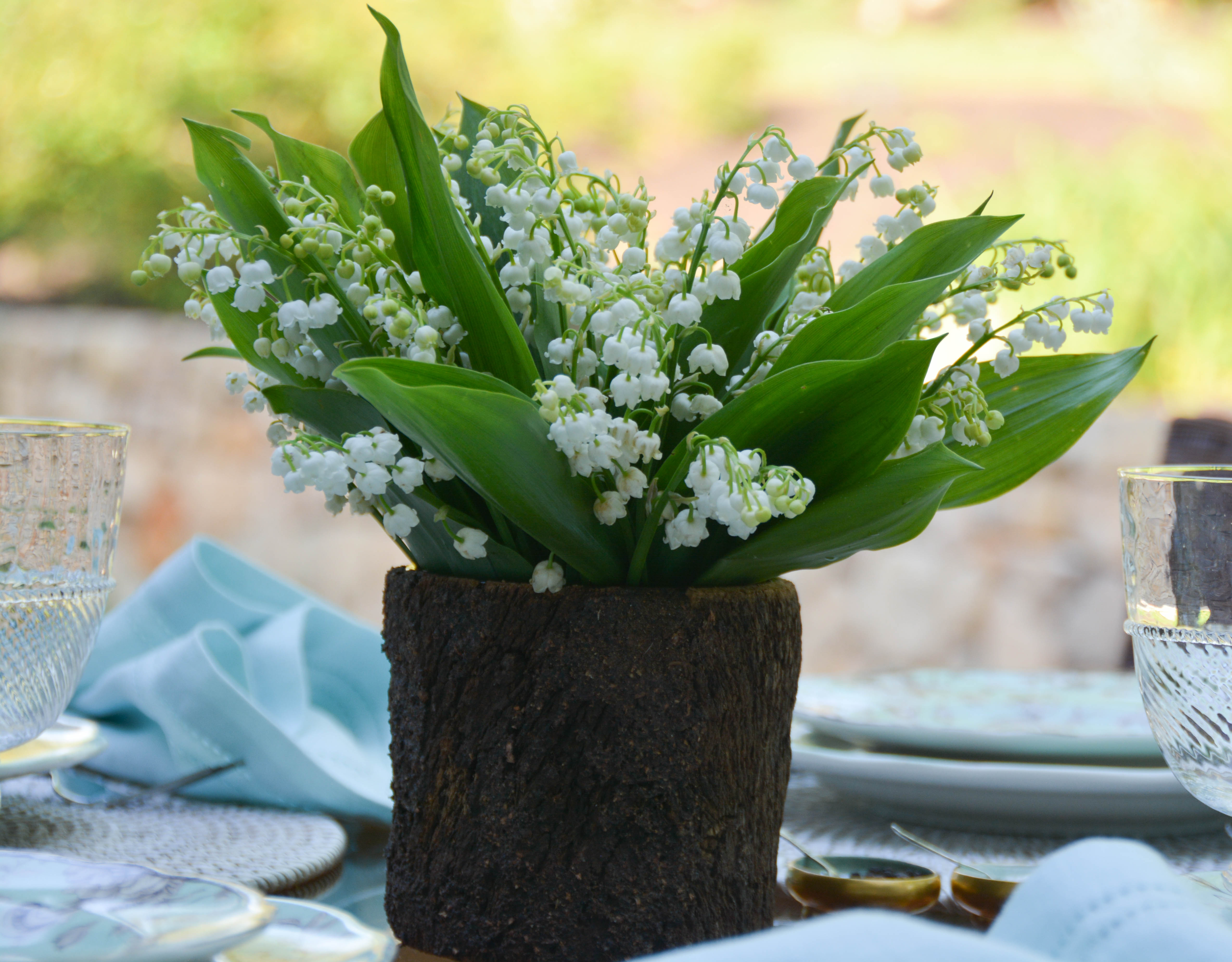 Hawthorne light turquoise with lilies of the valley entertablement the lilies of the valley are blooming in earnest and ive greedily collected a bouquet for the table izmirmasajfo