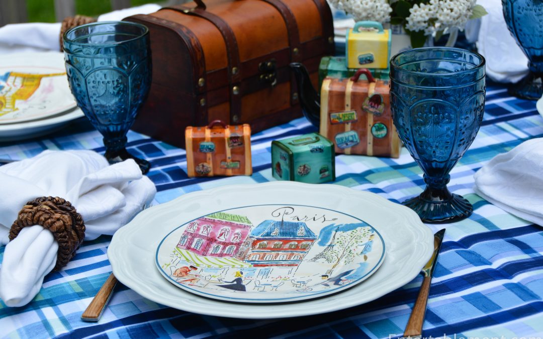 Table with luggage salt, pepper and teapot and travel plates