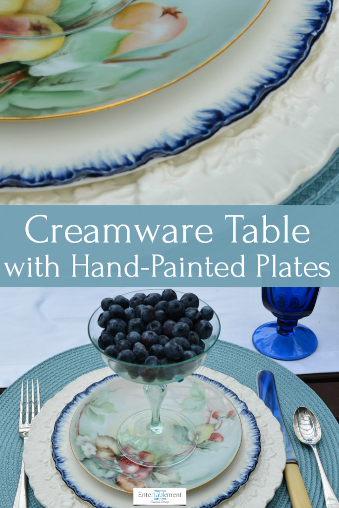 table set with shell edged creamware and hand painted berry plates