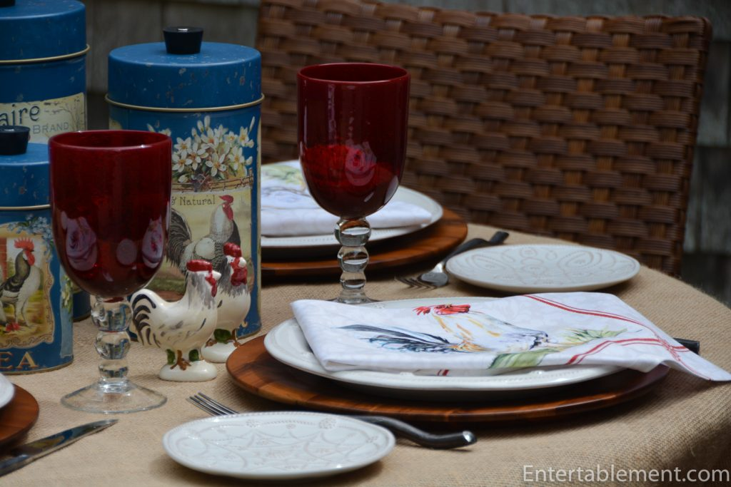 table with red glasses and rooster theme