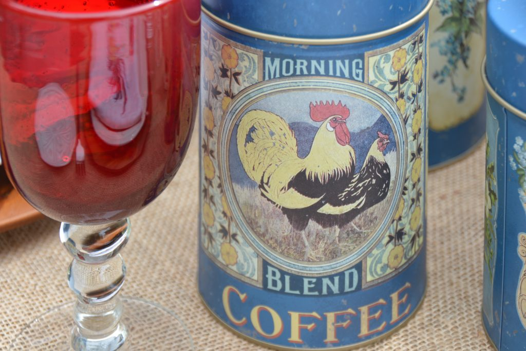 Two roosters on French Blue Coffee canister