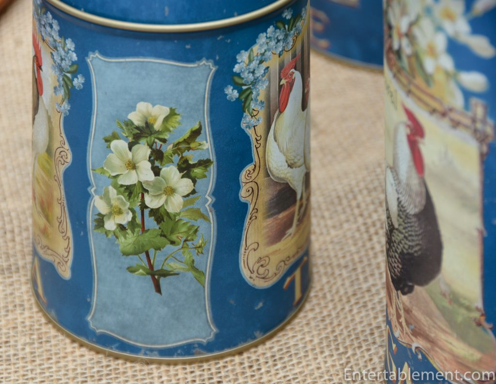 flowers on sides of blue canisters
