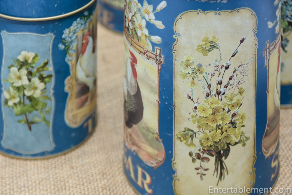 flowers on blue rooster canisters