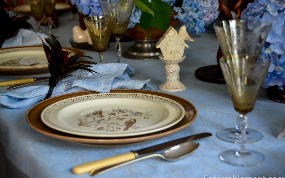 A Blue & Brown Table with Williamsburg Wedgwood Aviary